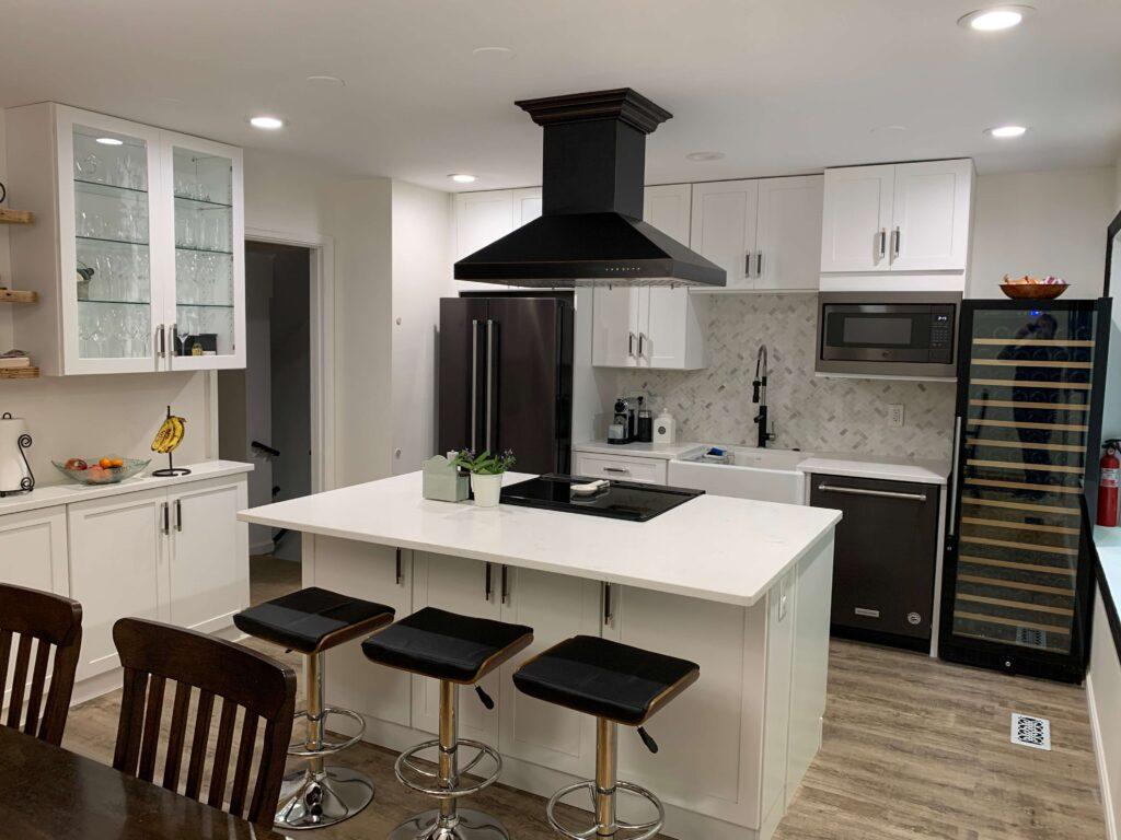 White kitchen cabinets design with white countertop
